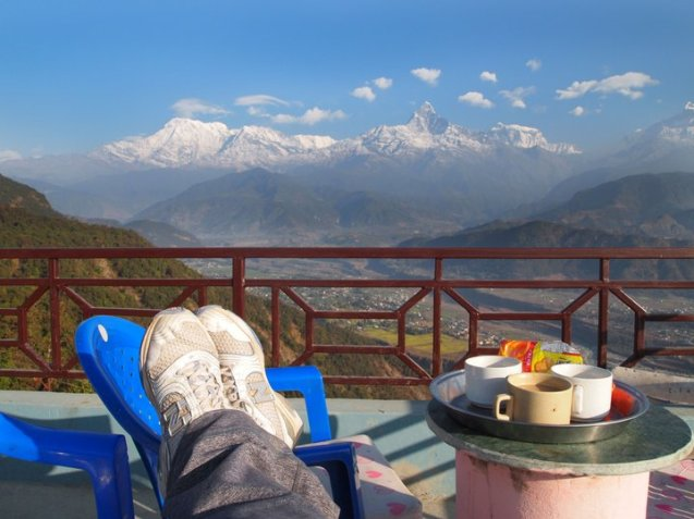 enjoying the view with a cup of chai