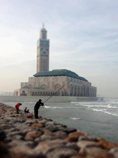 Local fishermen outside the Mohammed V Mosque in Casablanca, Morocco