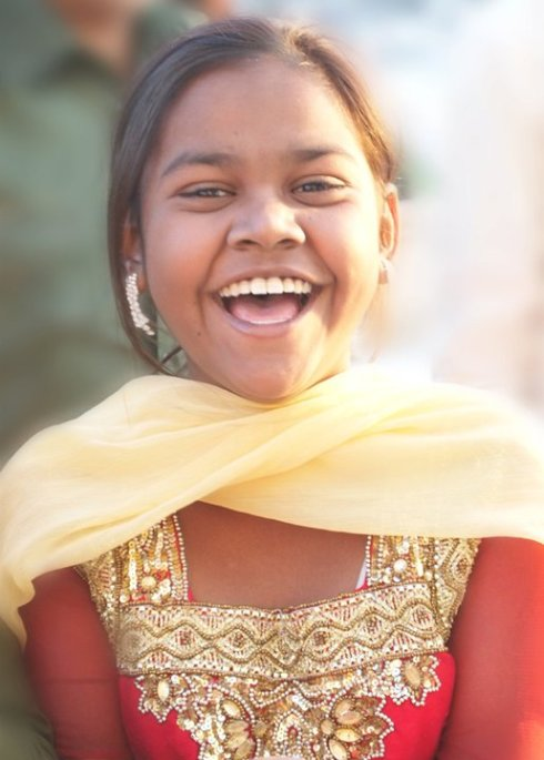 This young lady had the most infectious smile - we met at the Taj Mahal in India