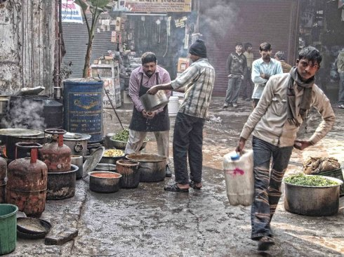 Vendors getting ready for the market to open - New Delhi, India