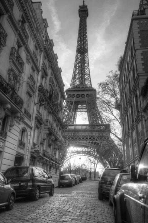 The detail in the architecture competed with the Eiffel Tower in the background. Turning the picture black and white helps the viewer to see more detail